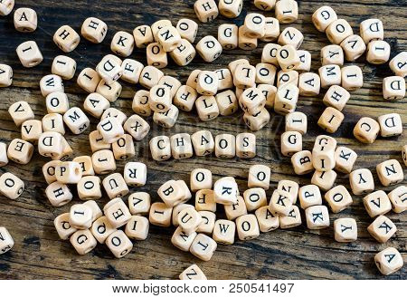 Wooden Dice With Letters In Disarray And The Word Chaos