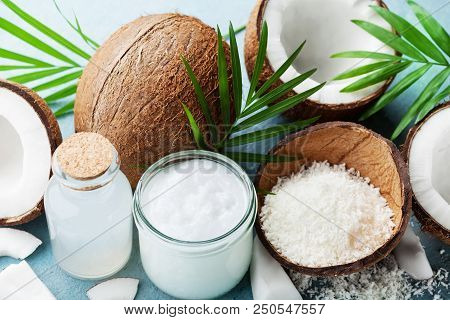 Set Of Organic Coconut Products For Spa, Cosmetic Or Food Ingredients Decorated Palm Leaves. Coconut