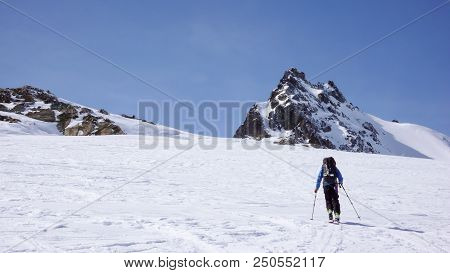 Male Backcountry Skier Going Up A Snow Slope In The Backcountry Of The Swiss Alps On A Ski Tour In W