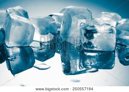 Melting Ice Cubes On A Glossy Table