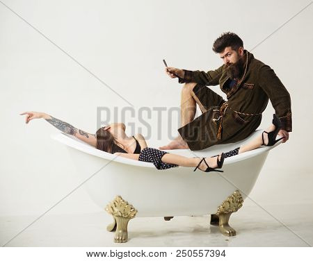 Couple Of Bearded Man And Sensual Woman In Bathroom. Couple Enjoy Morning Routing. Family Couple Rel