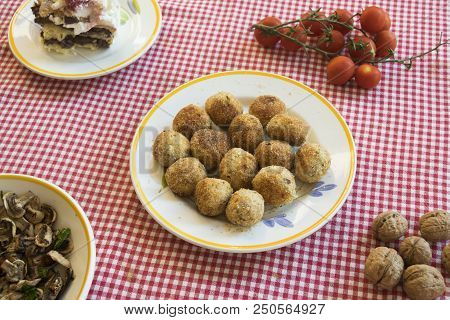 Deep Fried Rissoles Rolled In Breadcrumbs On A Set Table