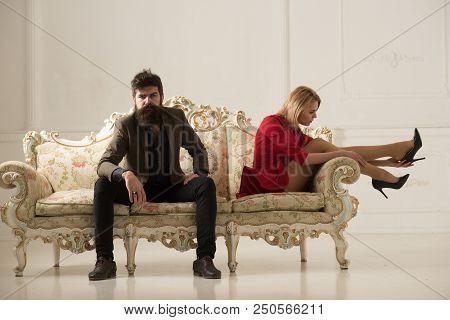 Shop Assistant. Bearded Man Shop Assistant Helps Woman To Choose Shoes. Shop Assistant Concept. Woma