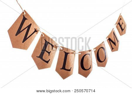 Welcome Banner. Welcome Text Hanging On Bunting In Selective Focus Against White Background. The Wor