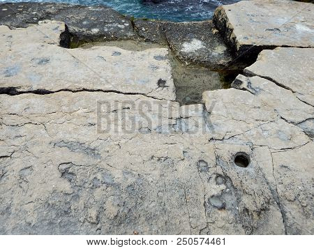 Rocky Shore Of The Caspian Sea. The Texture Of The Rocky Shore.