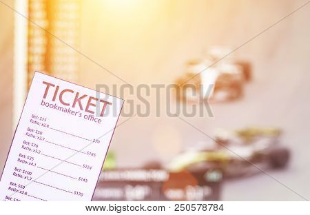 Ticket Bookmakers On The Background Of Racing Formula 1, Sports Betting, Sunset, Televisor