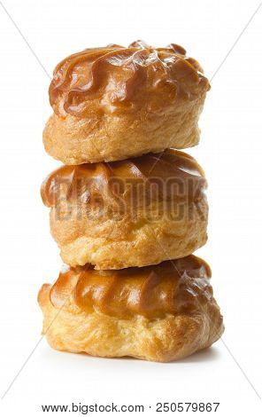 Pile Of French Eclairs Isolated On White Background
