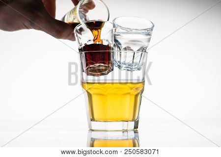 Godfather Yellow Cocktail In Glass, Near A Shot With White And A Shot With Brown Luqiid