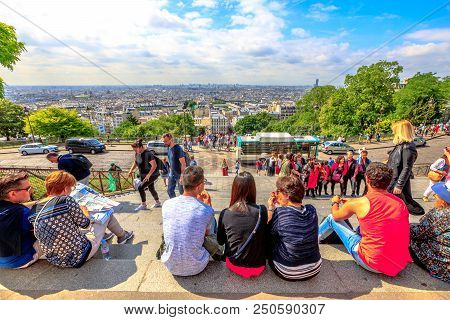 Paris, France - July 3, 2017: People On Stairs Of Sacre-coeur Basilica Enjoy The View Of Montmartre