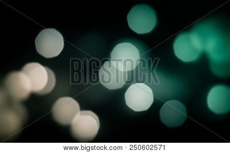 Abstract Blurred Circles On A Black Background.