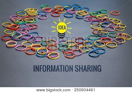 Information Sharing Concept, Colorful Rubber Band With Word Information Sharing And Idea Lighting Bu