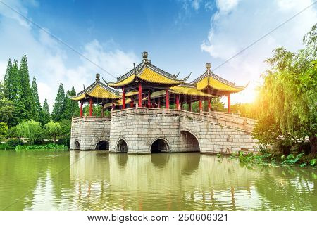 Ive Pavilion Bridge (also Known As Lotus Bridge) On The Lender West Lake. The Chinese Texts On The B