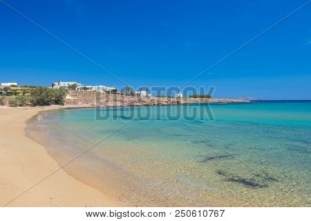 Sandy beach with amazing tranquil water on Paros island, Cyclades, Greece.