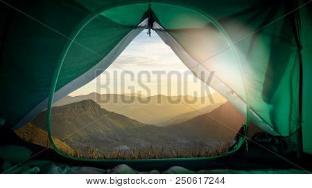 open camping tent with a breathtaking view over a wonderful mountain scenery