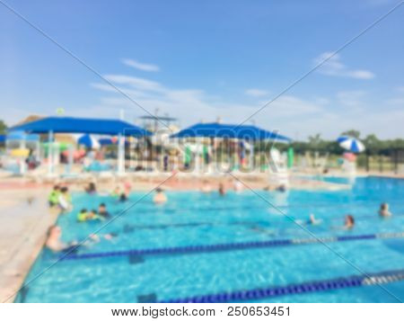 Abstract Blurred Kids And Parents At Community Swimming Pool