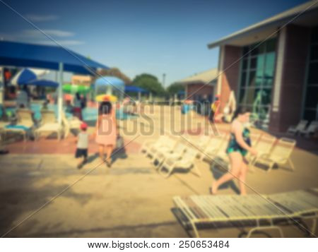 Vintage Blurred Outdoor Pools With Play Area, Slides, And Lap Lanes