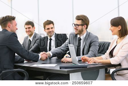 handshake of a Manager and a customer at the Desk