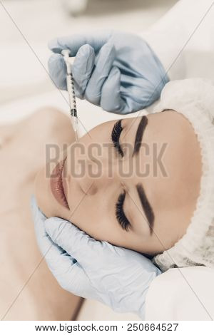 Close Up. Doctor Doing Procedure In Modern Clinic. Cosmetologist In Modern Clinic. Professional Of D