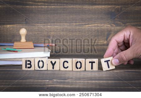 Boycott. Wooden Letters On The Office Desk, Informative And Communication Background