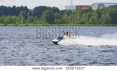 People Riding On A Jet Ski. High Speed Jetski With Water Spray. People Rid On Water Scooter.