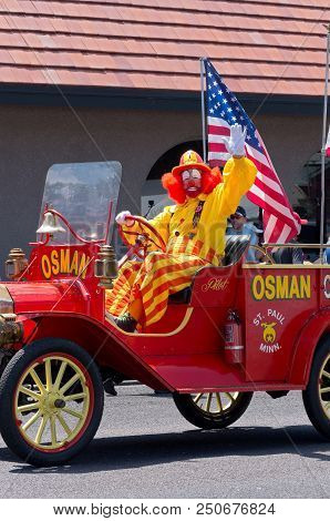 Mendota, Mn/usa - July 14, 2018: Osman Shriners Circus Clown Waves To Crowd From Decorated Vehicle A