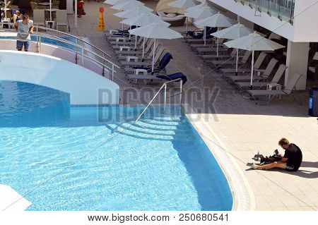Sunconnect Sofianna, Paphos, Cyprus, Greece - June 3, 2018 : Videographer Filming The Swimming Pool