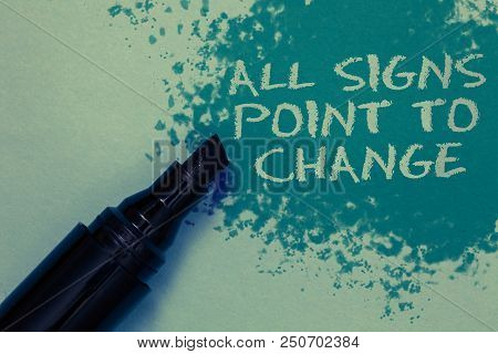 Conceptual hand writing showing All Signs Point To Change. Business photo showcasing Necessity of doing things differently new vision Sprinkle blue color on floor marker beside some outline text poster