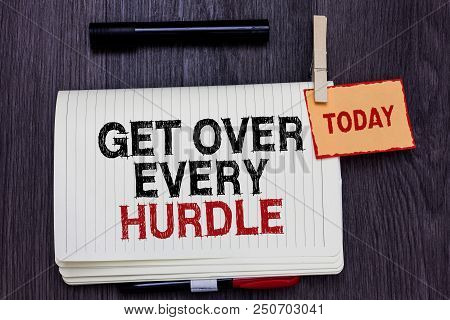 Handwriting text writing Get Over Every Hurdle. Concept meaning Overcome any obstacle problem trouble adversities Written paper on wooden desk paper clip grip note with red words black pen poster