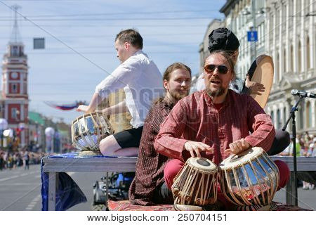 ST. PETERSBURG, RUSSIA - MAY 27, 2018: Percussion band on Nevsky avenue during Drummers parade. The parade is a part of City Day celebrations which is timed to day of foundation of Saint Petersburg