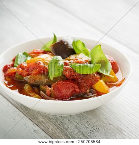 Ratatouille - French Vegetable Stew With Tomotoes, Aubergines, Courgettes And Peppers.