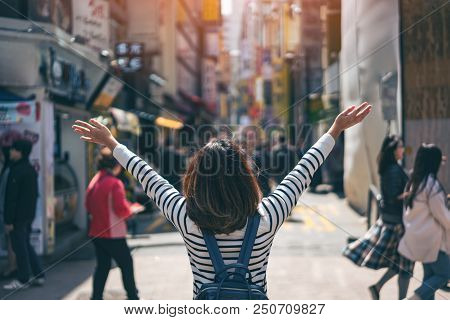 Young Asian Woman Traveler Traveling With Happiness And Shopping In Myeongdong Street Market At Seou