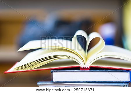 Love To Reading Books Concept : Stack Of Books And Open Book Heart Shape On The Table. Library, Educ