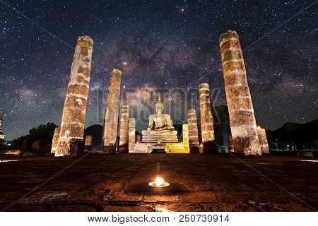 Buddha Statue at Wat Mahathat, buddha temple with milky way, in Sukhothai Histo poster