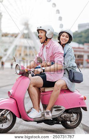First Ride. Jovial Joyful Man Conducting Motorbike And Woman Looking At Camera