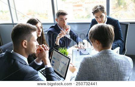 Brainstorm. Group Of Business People Looking At The Laptop Together. One Business Woman Looking At C