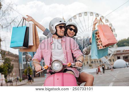 Energetic Weekend. Jovial Merry Man Driving Motorbike And Woman Carrying Bag