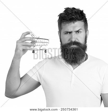 E-commerce And Shopping Concept. Bearded Man Wearing White T-shirt Holding Mini Shopping Cart On Rig