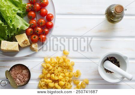 Italian Pasta Food Ingredients On White Wooden Table