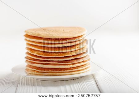Big Stack Of Pancakes On White Wooden Table