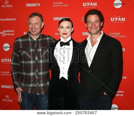 PARK CITY, UT / USA - JAN 20, 2018: (L-R) Wash Westmoreland, Keira Knightley and Dominic West attend the