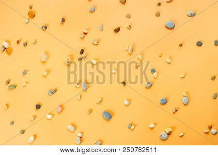Abstract Background With Little Stones On Yellow Surface