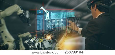 Iot Industry 4.0 Concept,industrial Engineer(blurred) Using Smart Glasses With Augmented Mixed With