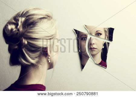 Woman Looking At Her Face In Three Shards Of Broken Mirror Pieces
