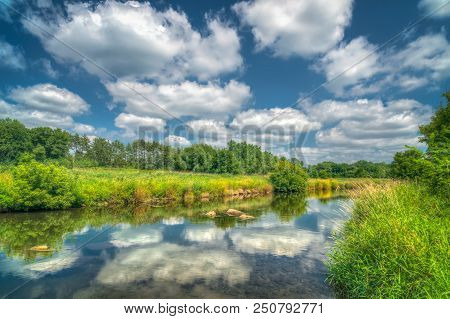 Reflecting Clouds On Summer Day Along The Willow River In St. Croix County, Wisconsin, Usa.