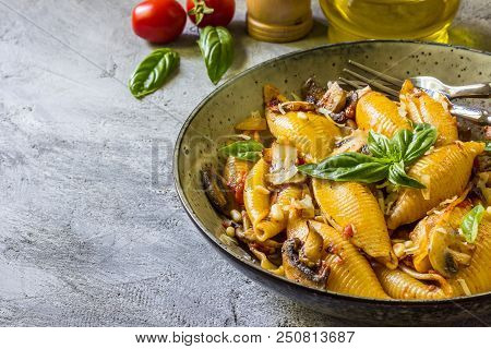 Pasta Conchiglioni With Mushrooms In A Vintage Bowl On A Dark Stone Or Concrete Background. Selectiv