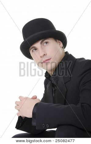 Man in black austere suit and hat