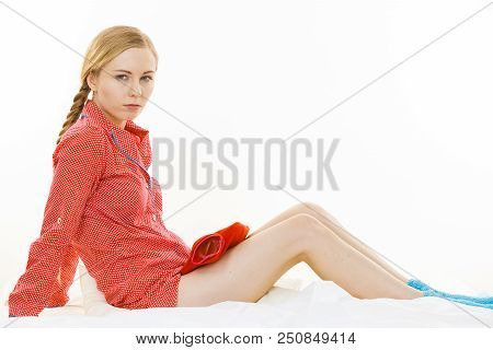 Woman Holding Warm Red Hot Water Bottle, Muscle Warming Up. Fever, Flu Treatment Objects Concept.