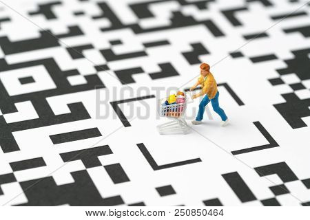 Miniature People Figurine, A Man With Grocery In The Shopping Cart At The Center Of Labyrinth Qr Cod