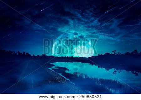 Photo Manipulation. Beautiful Night Sky With Many Stars And Meteor Shower. Landscape Of Blue Sky Wit