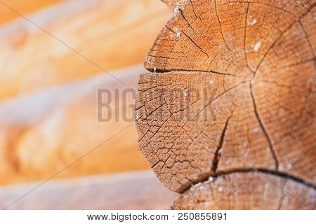 Close Up Angle Of Logs On The Side Of A Log Cabin Building.